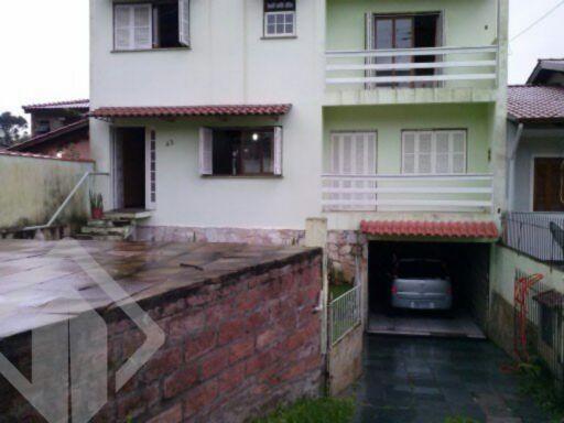 Casa de 5 dormitórios à venda em Vila Nova, Porto Alegre - RS