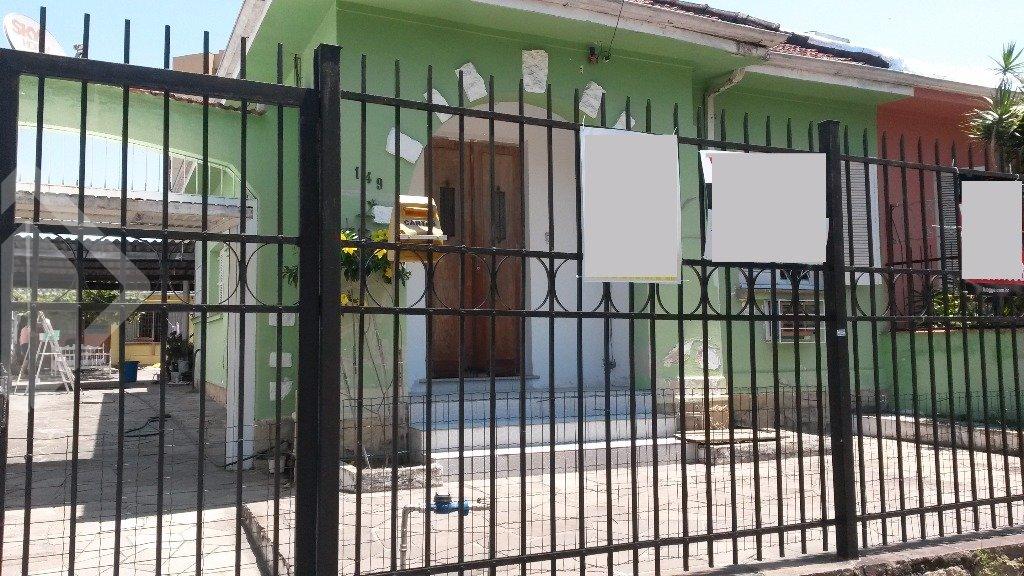Auxiliadora Predial vende: casa térrea de 2 dormitórios, com amplo pátio e edícula, banheiro social, sala de estar  e churrasqueira. Agende sua visita com a corretor  licenciado.