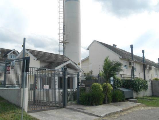 Casa em condomínio 4 quartos para alugar no bairro Jardim Itu Sabara, em Porto Alegre
