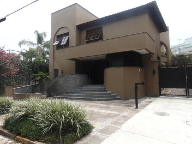 Casa em condomínio 3 quartos para alugar no bairro Tres Figueiras, em Porto Alegre